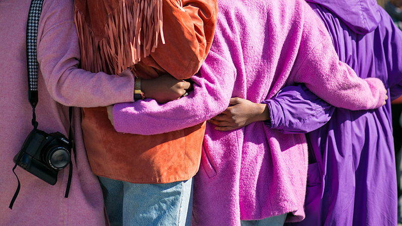 women dressed in colourful coats